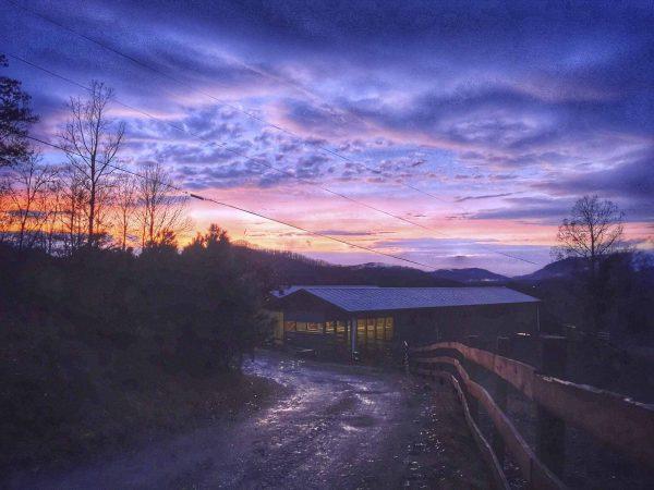 sunset over a barn