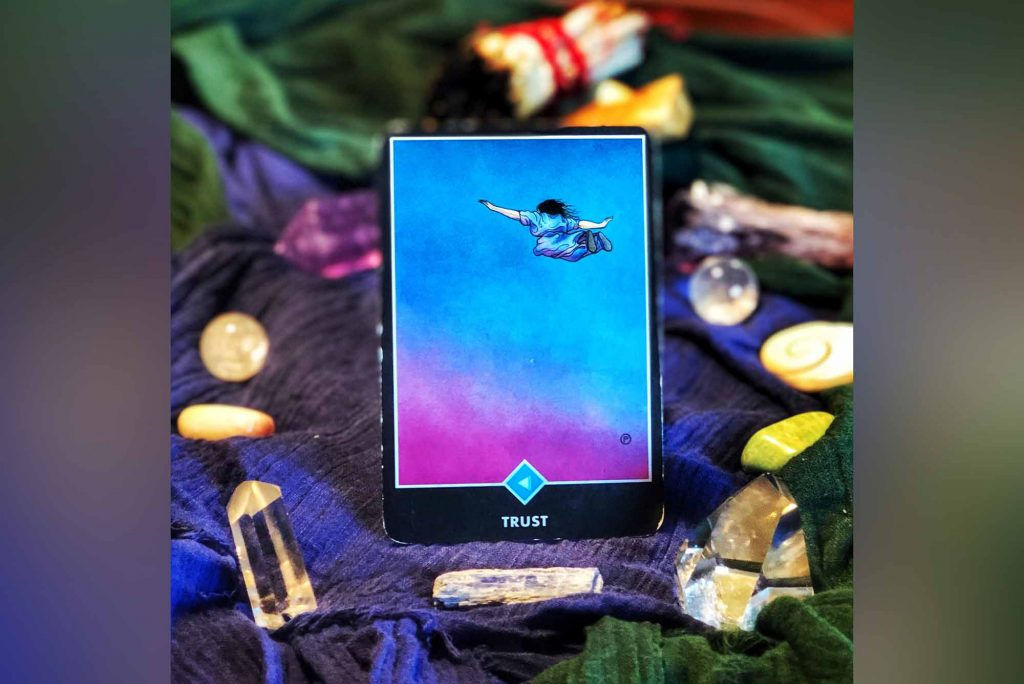 tarot card called trust of person floating down through a beautiful blue sky