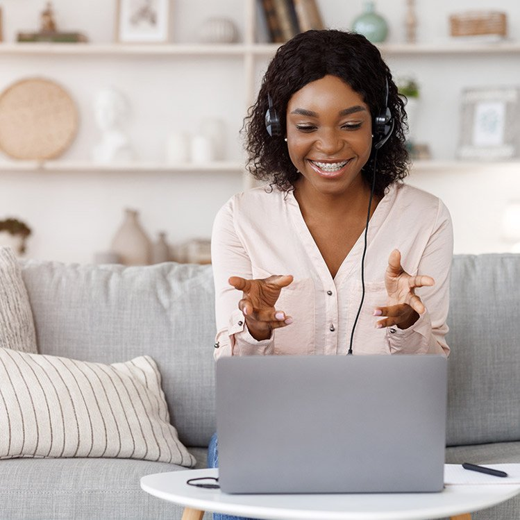 woman talking to someone on a computer video meeting